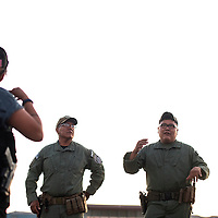 061819      Cayla Nimmo<br /> <br /> Detectives Neil Yazzie, left, and Steven Collins lead a certification class for night shooting for the Gallup Police Department at the gun range near Mentmore Thursday.
