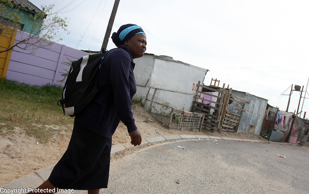 A nurse from the Philani Maternal, Child Health and Nutrition Trust heads out on her rounds in Khayelitsha Township.<br /> Photo by Shmuel Thaler <br /> shmuel_thaler@yahoo.com www.shmuelthaler.com
