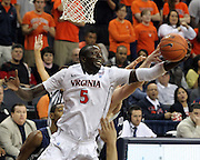 CHARLOTTESVILLE, VA- December 3: Assane Sene #5 of the Virginia Cavaliers grabs a rebound during the game on December 27, 2011 against the Longwood Lancers at the John Paul Jones Arena in Charlottesville, Virginia. Virginia defeated Longwood 86-53. (Photo by Andrew Shurtleff/Getty Images) *** Local Caption *** Assane Sene