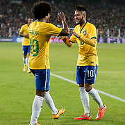 Brazil's Neymar JR (R) celebrate his goal with team mate during their a international friendly soccer match Turkey betwen Brazil at Sukru Saracoglu Arena in istanbul November 12, 2014. Photo by Aykut AKICI/TURKPIX