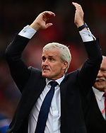 Mark Hughes, the manager of Stoke celebrates after his sides win. Premier league match, Stoke City v Arsenal at the Bet365 Stadium in Stoke on Trent, Staffs on Saturday 19th August 2017.<br /> pic by Bradley Collyer, Andrew Orchard sports photography.