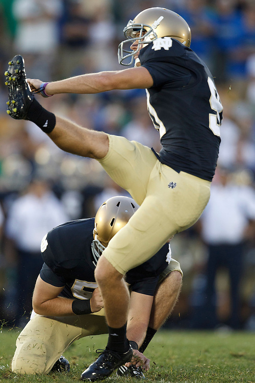 Notre Dame kicker David Ruffer (#97) attempts field goal in action during NCAA football game between Notre Dame and South Florida.  The South Florida Bulls defeated the Notre Dame Fighting Irish 23-20 in game at Notre Dame Stadium in South Bend, Indiana.
