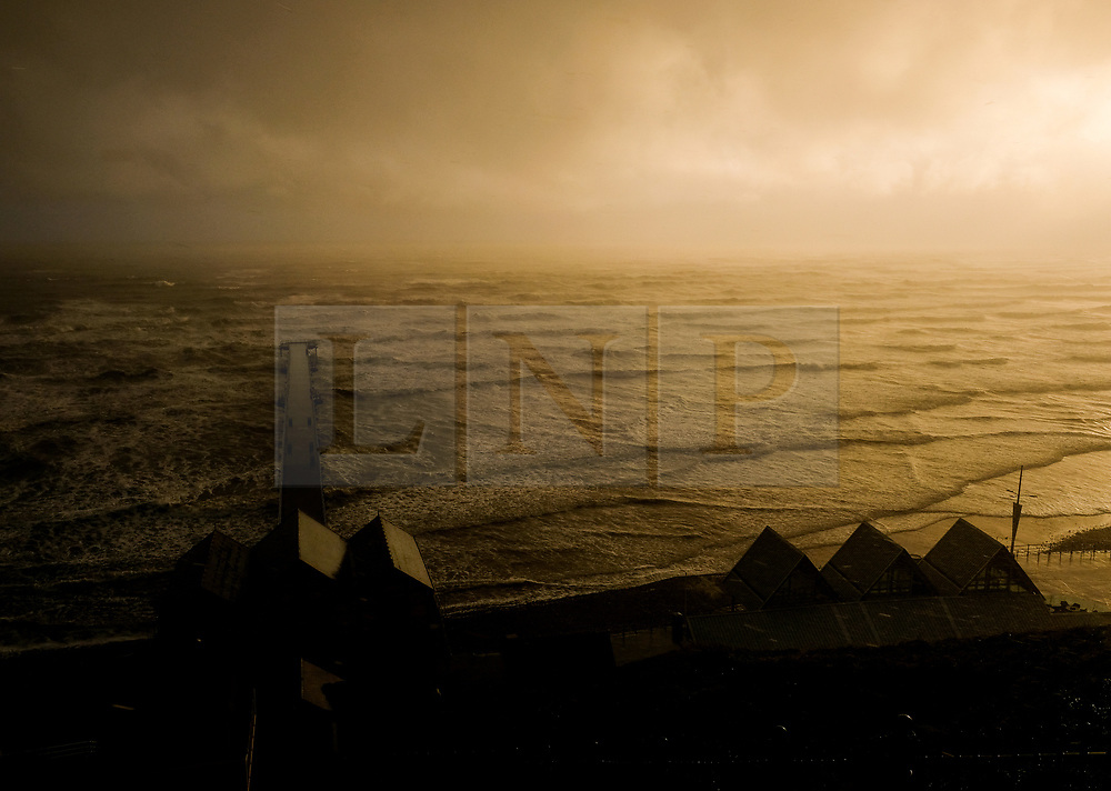 © Licensed to London News Pictures. <br /> 26/04/2017. <br /> Saltburn-By-The-Sea, UK.  <br /> <br /> An ethereal light from the morning sun shines through storm clouds over the pier at Saltburn-By-The-Sea as unseasonably cold Arctic weather sweeps across the country.<br /> <br /> Photo credit: Ian Forsyth/LNP