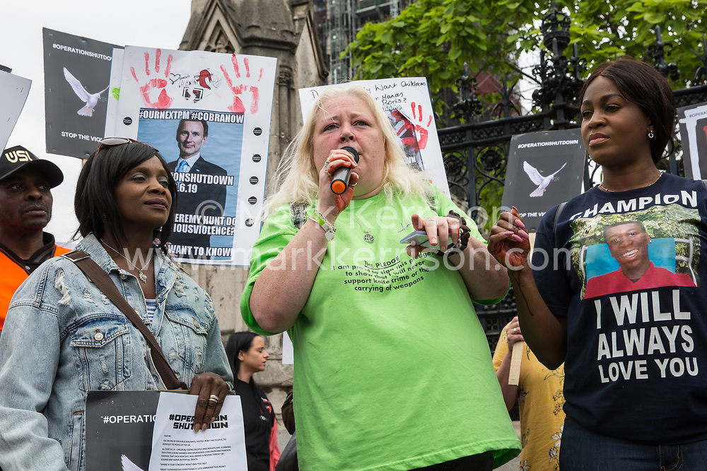 London, UK. 26 June, 2019. Campaigners against knife crime, including families who have lost loved ones to knife crime, protest outside Parliament as part of Operation Shutdown to put pressure on the Government, and in particular the next Prime Minister, to take urgent action to prevent knife crime and to protect its citizens. Credit: Mark Kerrison/Alamy Live News