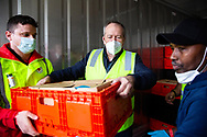 Former Labor Leader Bill Shorten (centre) is seen unloading a truck full of halal meat for the residents affected in the Alfred Street tower which is still under hard lockdown during COVID-19 on 10 July, 2020 in Melbourne, Australia. Former Federal Labor Leader Bill Shorten, along with close allies at Trades Hall help deliver Halal meat, supplied by Macca Halal Foods to the locked down housing commission towers following a coronavirus outbreak detected inside the complex. Mr Shorten was able to use his high profile to ensure food was not turned away by police so that it would reach the residents inside. (Photo be Dave Hewison/ Speed Media)