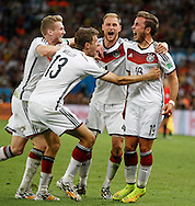 Germany's Mario Götze (right) celebrates scoring their first goal with team mates during the 2014 FIFA World Cup Final match at Maracana Stadium, Rio de Janeiro<br /> Picture by Andrew Tobin/Focus Images Ltd +44 7710 761829<br /> 13/07/2014