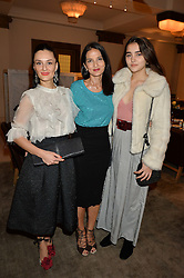 Left to right, AYTAN ELDAROVA, YASMIN MILLS and MADDIE MILLS at the unveiling of a Very Special Malone Souliers Christmas Tree, In Support Of Starlight Children's Foundation held at The Club Cafe Royal, Regent Street, London on 2nd December 2015.