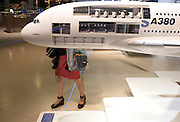 Legs and scale model of an A380 airliner displayed at Airbus/EADS stand during the Paris Air Show exhibition Le Bourget