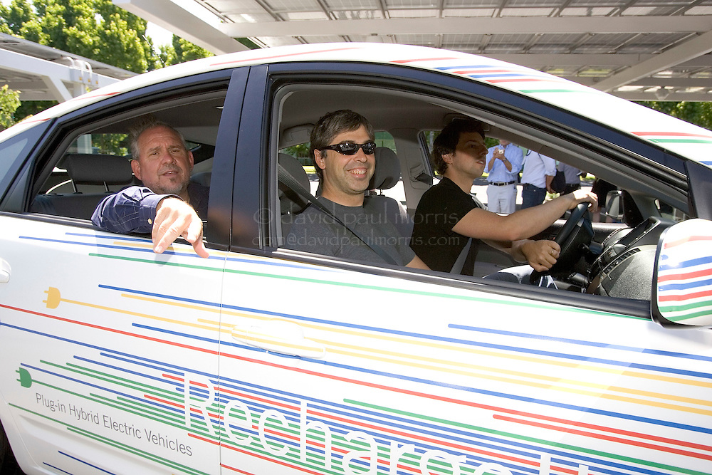 MOUNTAIN VIEW,  CA - JUNE 18:  (L-R) Google.org CEO Dr. Larry Brilliant, Google co-founders, Larry Page and Sergey Brin drive in a new plug-in hybrid car during a press conference launching the new fleet of new plug in hybrid electric cars on June 18, 2007 in Mountain View, California.  (Photograph by David Paul Morris)
