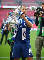 Chelsea's Eden Hazard celebrates with champagne after the game