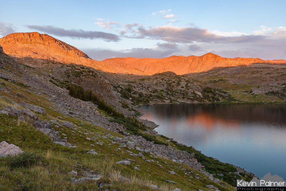 This was the view above Mistymoon Lake in the Cloud Peak Wilderness on Friday night. After hiking past this spot on the first day of my backpacking trip, I knew I would have to pitch my tent here the second night. When storms rolled through around 6:30, I was beginning to doubt if there would be a good sunset. But then the sun broke through in the west. First the sunlight painted the lower slopes of Bomber Mountain a salmon hue, but then the colors intensified further. There's something magical about a sunset at 10,000 feet. The mountain got it's name after a B-17 bomber crashed there during World War II. The crash site wasn't found until after the war and the wreckage still remains today.