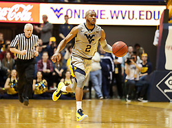 Jan 15, 2018; Morgantown, WV, USA; West Virginia Mountaineers guard Jevon Carter (2) dribbles the ball during the second half against the Kansas Jayhawks at WVU Coliseum. Mandatory Credit: Ben Queen-USA TODAY Sports