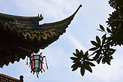 Chinese lantern hanging from traditional style roof, in the Yu Gardens, Shanghai, China<br /> FINE ART PHOTOGRAPHY by Tim Graham