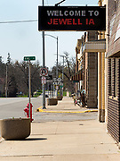 "26 APRIL 2020 - JEWELL, IOWA: Main Street  in Jewell, a small community in central Iowa, that became a food desert when the only grocery store in town closed in 2019. It served four communities within a 20 mile radius of Jewell. Some of the town's residents are trying to reopen the store, they are selling shares to form a co-op, and they hold regular fund raisers. Sunday, they served 550 ""grab and go"" pork roast dinners. They charged a free will donation for the dinners. Despite the state wide restriction on large gatherings because of the COVID-19 pandemic, the event drew hundreds of people, who stayed in their cars while volunteers wearing masks collected money and brought food out to them. Organizers say they've raised about $180,000 of their $225,000 goal and they hope to open the new grocery store before summer.       PHOTO BY JACK KURTZ"