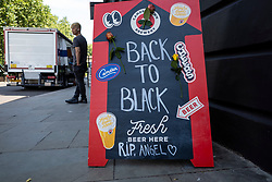 © Licensed to London News Pictures. 23/07/2021. LONDON, UK.  A sign makes reference to Back to Black, a song by Amy Winehouse, outside the Hawley Arms, her favourite pub in Camden Town, on the tenth anniversary of the late singer's death.  Photo credit: Stephen Chung/LNP