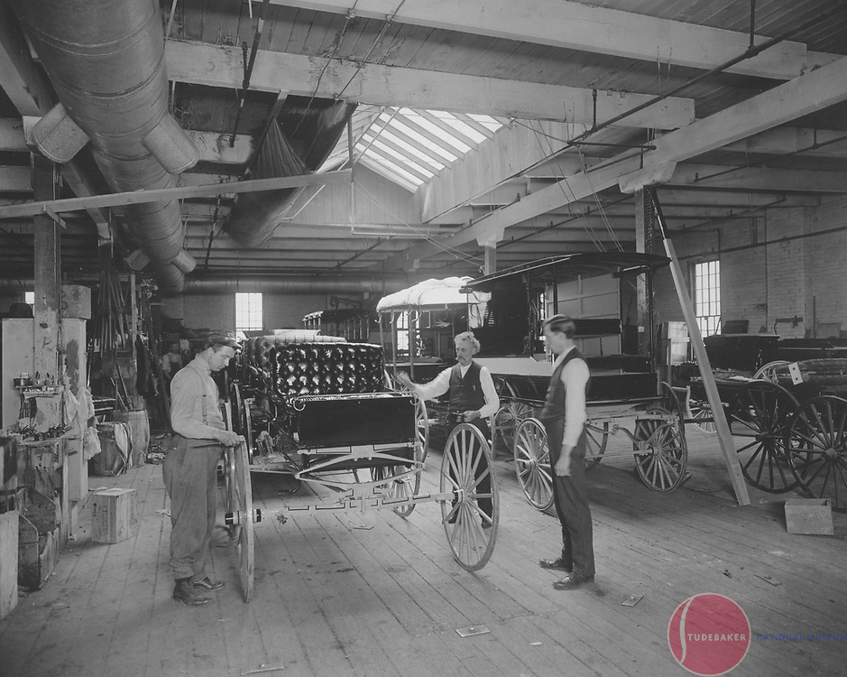 Studebaker workmen inspect a buggy at Studebaker's South Bend plant c. 1900