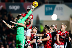 Aden Flint of Bristol City is challenged by Marcus Bettinelli of Fulham as Kevin McDonald of Fulham collides with his keeper - Rogan/JMP - 21/02/2018 - Ashton Gate Stadium - Bristol, England - Bristol City v Fulham - Sky Bet Championship.
