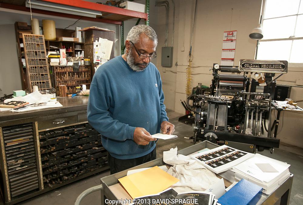 Bert Cox checks a die cut invitation at Harman Press, CA. Shot Feb. 19th,  2013 Photo by David Sprague ©2013