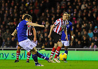 20111226: LONDON, UK - Barclays Premier League 2011/2012: Sunderland vs Everton.<br /> In photo: Leighton Baines of Everton FC (L) scores his side's first goal from the penalty spot..<br /> PHOTO: CITYFILES