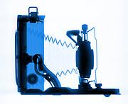 A early Kodak Camera Model #18 folding camera is shown in X-ray.
