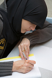 Girl studying for her GCSEs at the Nottingham Islamia school,