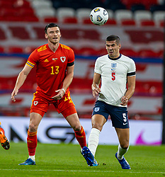 LONDON, ENGLAND - Thursday, October 8, 2020: Wales' Kieffer Moore (L) and England's Conor Coady during the International Friendly match between England and Wales at Wembley Stadium. The game was played behind closed doors due to the UK Government's social distancing laws prohibiting supporters from attending events inside stadiums as a result of the Coronavirus Pandemic. England won 3-0. (Pic by David Rawcliffe/Propaganda)