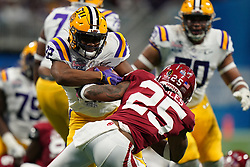 Clyde Edwards-Helaire #22 of the LSU Tigers runs the ball during the first half against the Oklahoma Sooners in the 2019 College Football Playoff Semifinal at the Chick-fil-A Peach Bowl on Saturday, Dec. 28, in Atlanta. (Paul Abell via Abell Images for the Chick-fil-A Peach Bowl)