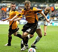 Photo: Ed Godden.<br />Wolverhampton Wanderers v Sheffield Wednesday. Coca Cola Championship. 25/03/2006. <br />Wolves' Tomasz Frankowski holds off Wednesdays Mikkel Bischoff (R).