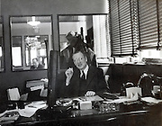 the factory manager posing at his desk USA 1940s