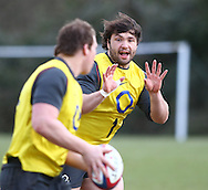 Alex Corbisiero (R) prepares to receive a pass from Dylan Hartley during the England elite player squad trainnig session at Pennyhill Park, Bagshot, UK, on 11th March 2011  (Photo by Andrew Tobin/SLIK images)