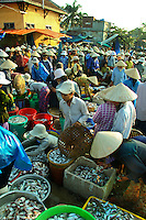 """Hoi An Wet Market - Though most Vietnamese markets are very colorful and active, Hoi An's """"wet"""" market positively hums and vibrates with action from morning till mid afternoon.  Here you'll find everything from fresh crabs to herbs and produce to souvenir items."""