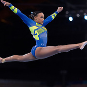 TOKYO, JAPAN - JULY 29:   Rebeca Andrade of Brazil performs her routine on the balance beam during her silver medal performance in the All-Around Final for Women at Ariake Gymnastics Centre during the Tokyo 2020 Summer Olympic Games on July 29, 2021 in Tokyo, Japan. (Photo by Tim Clayton/Corbis via Getty Images)