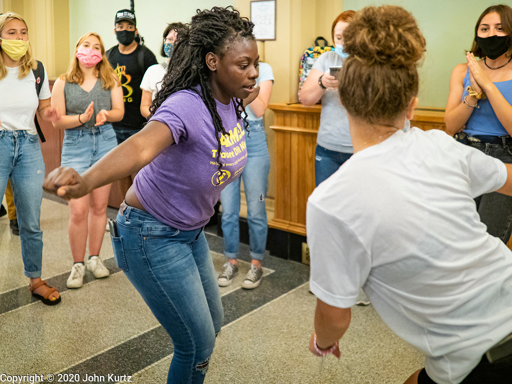 19 JUNE 2020 - DES MOINES, IOWA: Members of Black Lives Matter dance in the hallway in front of the Governor's office during a Juneteenth rally in the Iowa State Capitol. About 100 supporters of Des Moines Black Lives Matter finished their week long series of protests at the Iowa State Capitol with a Juneteenth rally and demonstration. They are demanding that Gov. Kim Reynolds use an executive order to restore voting rights to felons who have completed their sentences. The protesters did not meet with the Governor Friday. The protest was peaceful.      PHOTO BY JACK KURTZ
