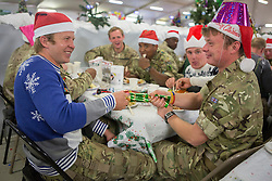 25/12/2013.  Members of the 9/12 Lancers join troops in Afghanistan as they enjoy their Christmas lunch today at Camp Bastion.  This  will be the last time the UK Armed Forces will be deployed over Christmas on operations in the country before the end of Op Herrick in 2014.  Photo credit: Alison Baskerville/LNP
