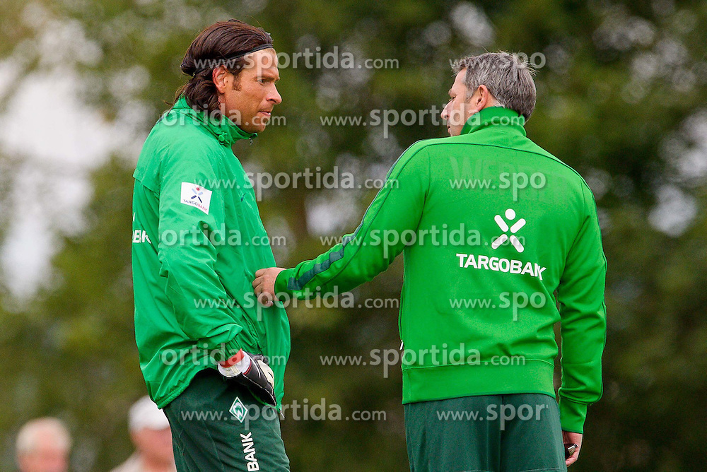 20.07.2011, Oeschberghof, Donaueschingen, Trainingslager 2011 GER, 1.FBL, Werder Bremen Trainingslager Donaueschingen 2011, im Bild Tim Wiese (Bremen #1) Klaus Allofs (Geschaeftsfuehrer Profifussball Werder Bremen) unterhalten sich .......// during the trainings session from GER, 1.FBL, Werder Bremen Trainingslager Donaueschingen 2011 on 2011/07/20,  Oeschberghof, Donaueschingen, Germany..EXPA Pictures © 2011, PhotoCredit: EXPA/ nph/  Kokenge       ****** out of GER / CRO  / BEL ******