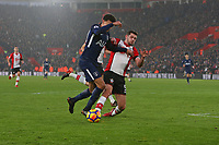 Football - 2017 / 2018 Premier League - Southampton vs. Tottenham Hotspur<br /> <br /> Southampton's Wesley Hoedt wins the ball from Dele Alli of Tottenham with a well timed tackle at St Mary's Stadium Southampton<br /> <br /> COLORSPORT/SHAUN BOGGUST