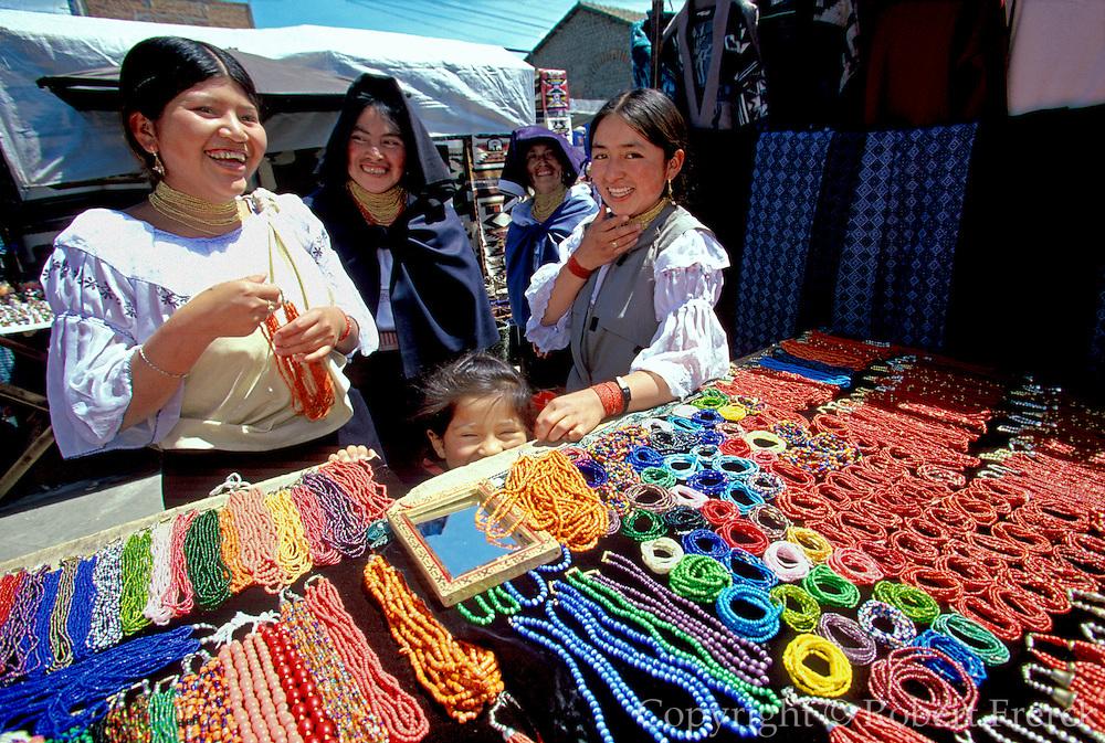 ECUADOR, MARKETS, CRAFTS Otavalo market woman and jewelry