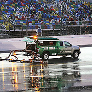 The Air Titan tries to dry the wet race track prior to the 57th Annual NASCAR Coke Zero 400 stock car race at Daytona International Speedway on Sunday, July 5, 2015 in Daytona Beach, Florida.  (AP Photo/Alex Menendez)
