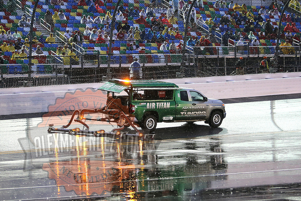 The Air Titan tries to dry the wet race track prior to the 57th Annual NASCAR Coke Zero 400 stock car race at Daytona International Speedway on Sunday, July 5, 2015 in Daytona Beach, Florida.  (AP Photo/Alex Menendez)