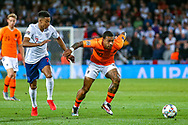 Netherlands forward Memphis Depay (Lyon) holds off England midfielder Jesse Lingard (Manchester United) during the UEFA Nations League semi-final match between Netherlands and England at Estadio D. Afonso Henriques, Guimaraes, Portugal on 6 June 2019.