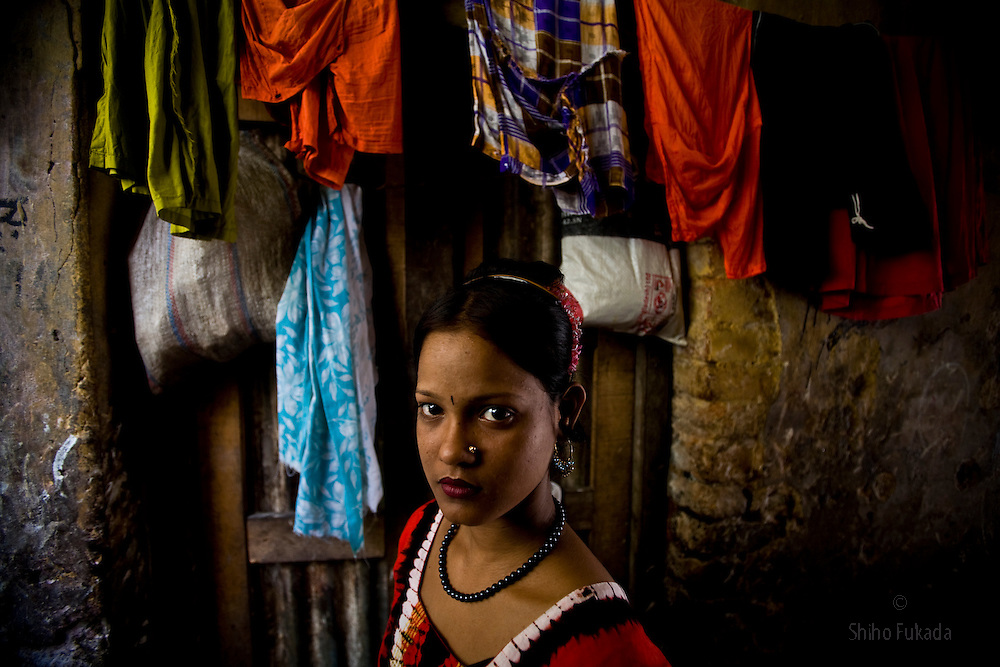 A young sex worker is seen at brothel in Mymensingh, Bangladesh. <br /> The majority of the 20,000 to 30,000 female sex workers in Bangladesh are victims of trafficking. <br /> Once they enter the brothel, usually before the age of 12, they are generally in for life because of social stigma and poverty.
