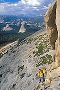 Climber on the regular route on Eichorn Pinnacle, Tuolumne Meadows area, Yosemite National Park, California