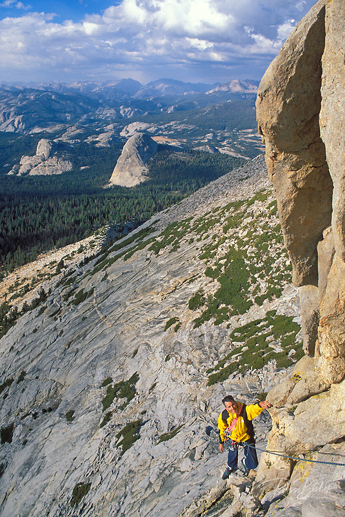Climber on the regular route on Eichorn Pinnacle, Tuolumne Meadows area, Yosemite National Park, California