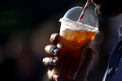 A spectator drinks Pimms on day two of the Wimbledon Championships at The All England Lawn Tennis and Croquet Club, Wimbledon.