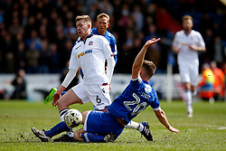 Jamie Stott of Oldham Athletic tackles Josh Vela of Bolton Wanderers - Mandatory by-line: Matt McNulty/JMP - 15/04/2017 - FOOTBALL - Boundary Park - Oldham, England - Oldham Athletic v Bolton Wanderers - Sky Bet League 1