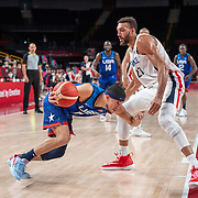 TOKYO, JAPAN - JULY 25:   Devin Booker #15 of the United States is defended by Rudy Gobert #27 of France during the USA V France basketball preliminary round match at the Saitama Super Arena at the Tokyo 2020 Summer Olympic Games on July 25, 2021 in Tokyo, Japan. (Photo by Tim Clayton/Corbis via Getty Images)
