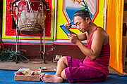 "19 AUGUST 2014 - BANGKOK, THAILAND:  A member of the Lehigh Leng Kaitoung Opera troupe applies his makeup before a performance at Chaomae Thapthim Shrine, a small Chinese shrine in a working class neighborhood of Bangkok. The performance was for Ghost Month. Chinese opera was once very popular in Thailand, where it is called ""Ngiew."" It is usually performed in the Teochew language. Millions of Chinese emigrated to Thailand (then Siam) in the 18th and 19th centuries and brought their culture with them. Recently the popularity of ngiew has faded as people turn to performances of opera on DVD or movies. There are still as many 30 Chinese opera troupes left in Bangkok and its environs. They are especially busy during Chinese New Year and Chinese holiday when they travel from Chinese temple to Chinese temple performing on stages they put up in streets near the temple, sometimes sleeping on hammocks they sling under their stage. Most of the Chinese operas from Bangkok travel to Malaysia for Ghost Month, leaving just a few to perform in Bangkok.           PHOTO BY JACK KURTZ"