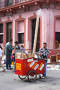 A market stall street market merchant selling caramelized peanuts, almonds and other things from a push cart with a mobile fire Montevideo, Uruguay, South America