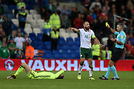 David Meyler , the captain of Republic of Ireland fouls Wales goalkeeper Wayne Hennessey ® and gets a yellow card off referee Damir Skomina. Wales v Rep of Ireland , FIFA World Cup qualifier , European group D match at the Cardiff city Stadium in Cardiff , South Wales on Monday 9th October 2017. pic by Andrew Orchard, Andrew Orchard sports photography