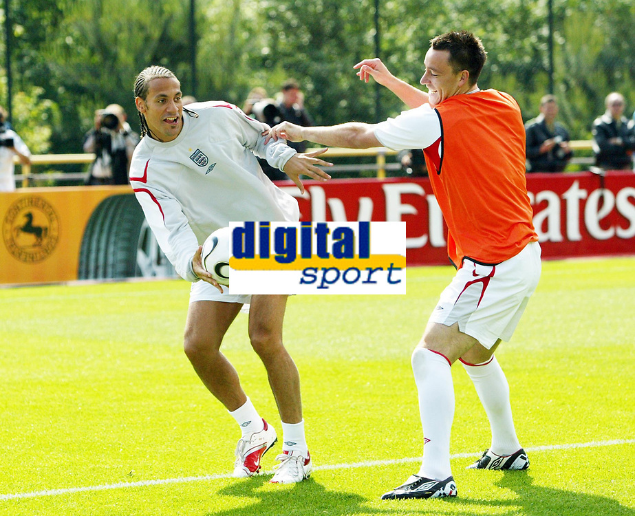 Photo: Chris Ratcliffe.<br />England training session. 06/06/2006.<br />Rio Ferdinand tussles with John Terry as England's warm up begins in the mountains of the Black Forest in Buhlertal.